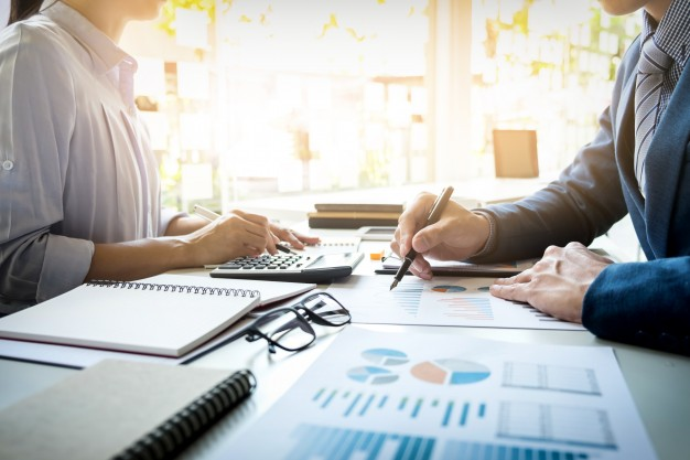business man financial inspector and secretary making report calculating or checking balance internal revenue service inspector checking document  - Simple Steps to Success: Setting up your Business made Simple