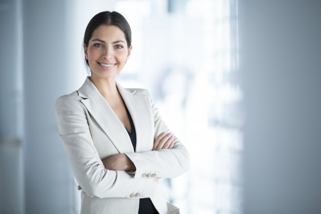 smiling female business leader with arms crossed 1262 3089 - Trailblazers: Creating Paths toward a Successful Business
